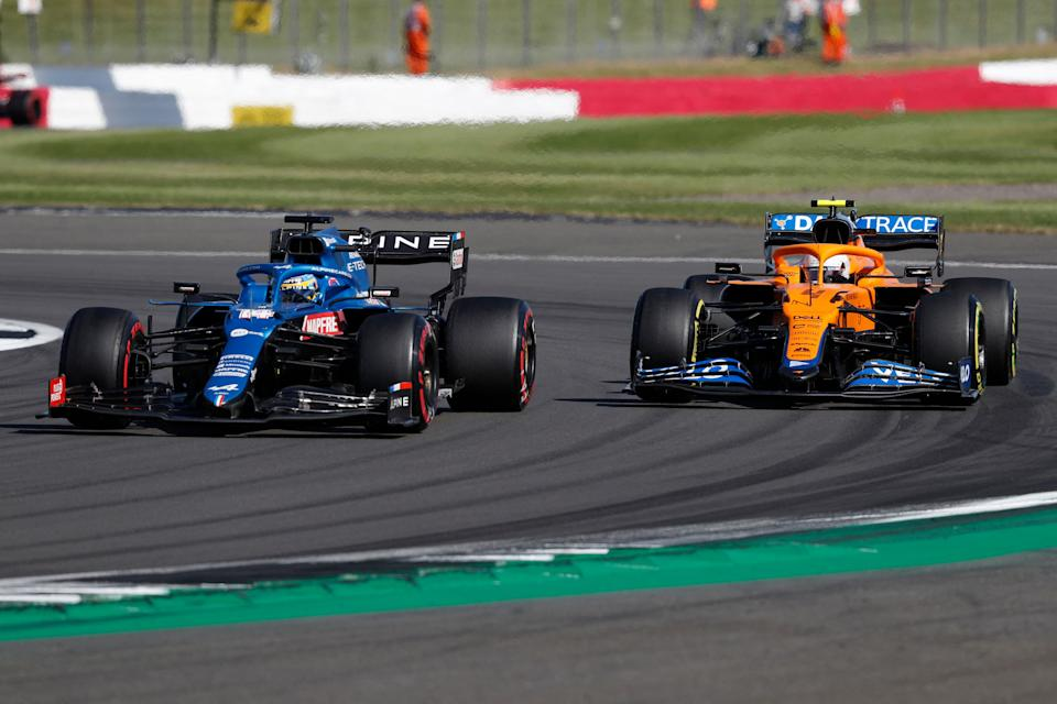 Alpine's Spanish driver Fernando Alonso (L) leads McLaren's British driver Lando Norris during the sprint session of the Formula One British Grand Prix at Silverstone motor racing circuit in Silverstone, central England on July 17, 2021. (Photo by Adrian DENNIS / AFP) (Photo by ADRIAN DENNIS/AFP via Getty Images)