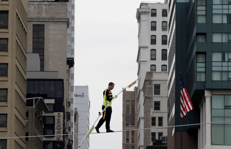 Daredevil Nik Wallenda walks on a tightrope above Baltimore's Inner Harbor, Wednesday, May 9, 2012. Wallenda, who holds five Guinness World Records, is a seventh-generation member of the Flying Wallenda family. (AP Photo/Patrick Semansky)