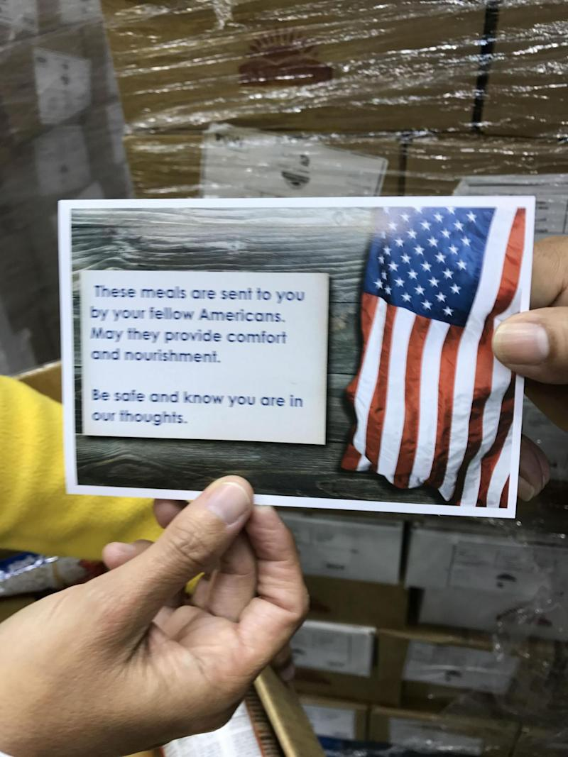 A postcard of American goodwill is included in every Fema food box along with the apple sauce and ravioli (David Usborne)