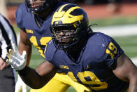 FILE - Michigan defensive lineman Kwity Paye is shown during the second half of an NCAA college football game against Michigan State in Ann Arbor, Mich., in this Saturday, Oct. 31, 2020, file photo. Paye is a possible first round pick in the NFL Draft, April 29-May 1, 2021, in Cleveland. (AP Photo/Carlos Osorio, File)