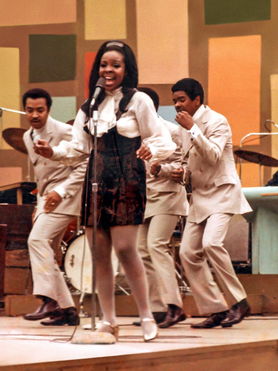 """This image released by Searchlight Pictures shows Gladys Knight and the Pips at the Harlem Cultural Festival in 1969, featured in the documentary """"Summer of Soul."""" (Searchlight Pictures via AP)"""