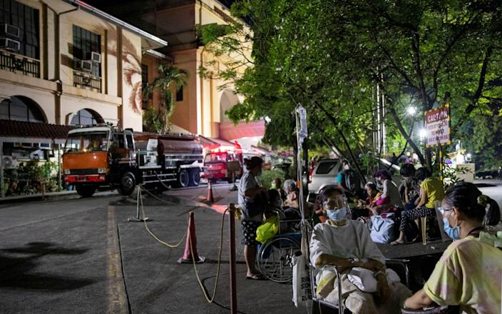 Patients of Philippine General Hospital are evacuated after a fire broke out at the facility - Eloisa Lopez/Reuters