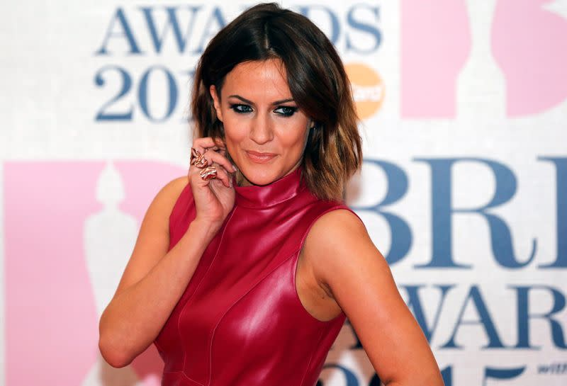 FILE PHOTO: Television presenter Caroline Flack arrives for the BRIT music awards at the O2 Arena in London