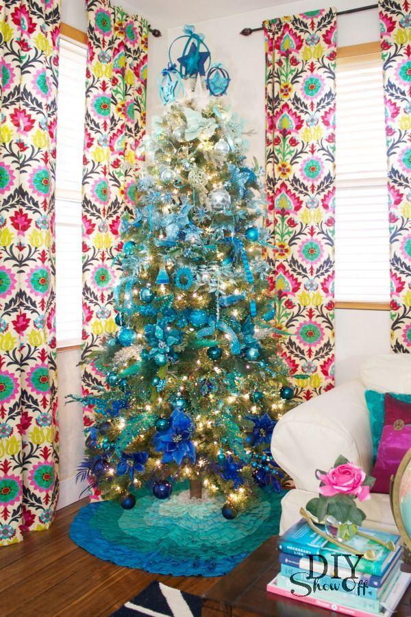 """<p>Blue is basically a runner-up Christmas color, so put it to good use this holiday season and turn your tree into a family art project. </p><p><strong><em>Get the tutorial at <a href=""""https://diyshowoff.com/2013/11/01/dream-tree-challenge-ombre-christmas-tree/"""" rel=""""nofollow noopener"""" target=""""_blank"""" data-ylk=""""slk:DIY Show Off"""" class=""""link rapid-noclick-resp"""">DIY Show Off</a>.</em></strong></p><p><a class=""""link rapid-noclick-resp"""" href=""""https://www.amazon.com/Christmas-Glitter-Poinsettia-Artificial-Ornaments/dp/B081HZFJHN/?tag=syn-yahoo-20&ascsubtag=%5Bartid%7C10070.g.2025%5Bsrc%7Cyahoo-us"""" rel=""""nofollow noopener"""" target=""""_blank"""" data-ylk=""""slk:BUY BLUE POINSETTIAS"""">BUY BLUE POINSETTIAS</a></p>"""