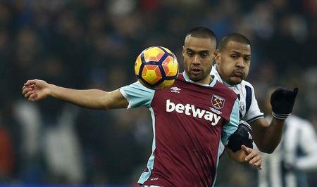 West Ham United's Winston Reid in action with West Bromwich Albion's Salomon Rondon