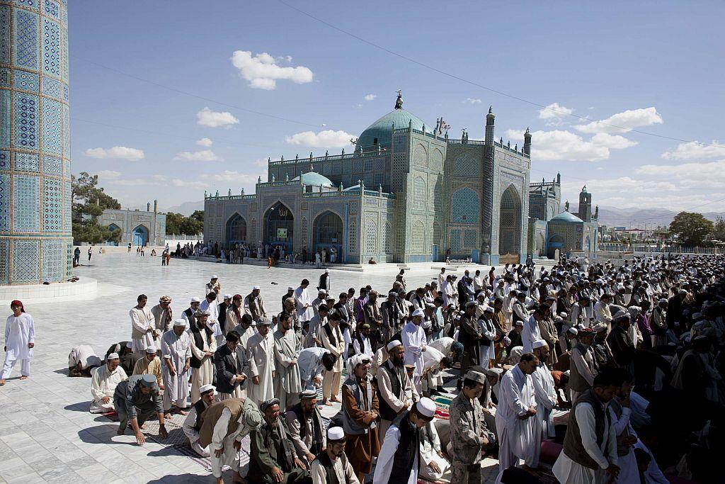 "<b>MAZAR-E-SHARIF, AFGHANISTAN: </b>Afghan men pray at the Blue Mosque. Mazar-e-Sharif means ""Noble Shrine"", a reference to the large, blue-tiled mosque around which the town is built."