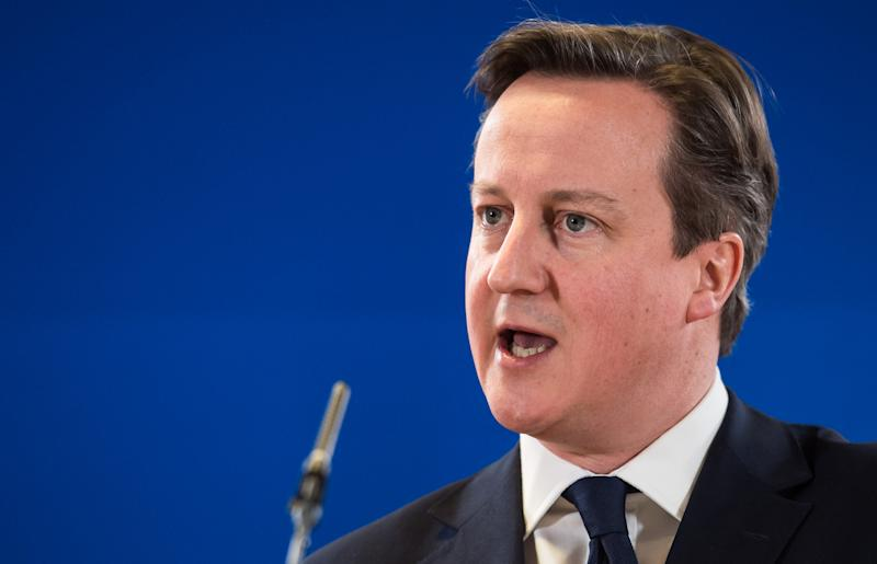 British Prime Minister David Cameron speaks during a media conference at an EU summit in Brussels on Thursday, March 6, 2014. European Union leaders held an emergency summit on Thursday to decide on imposing sanctions against Russia over its military incursion in Ukraine's Crimean peninsula. (AP Photo/Geert Vanden Wijngaert)