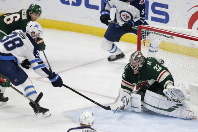 Winnipeg Jets right wing Logan Shaw (38) scores a goal on Minnesota Wild goalie Alex Stalock (32) in the third period of an NHL hockey game Saturday, Dec. 21, 2019, in St. Paul, Minn. The Jets defeated the Wild 6-0. (AP Photo/Andy Clayton-King)