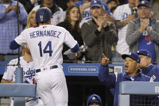 Los Angeles Dodgers' Enrique Hernandez, left, is congratulated by manager Dave Roberts during the third inning of a baseball game against the San Diego Padres, Friday, May 25, 2018, in Los Angeles. (AP Photo/Mark J. Terrill)