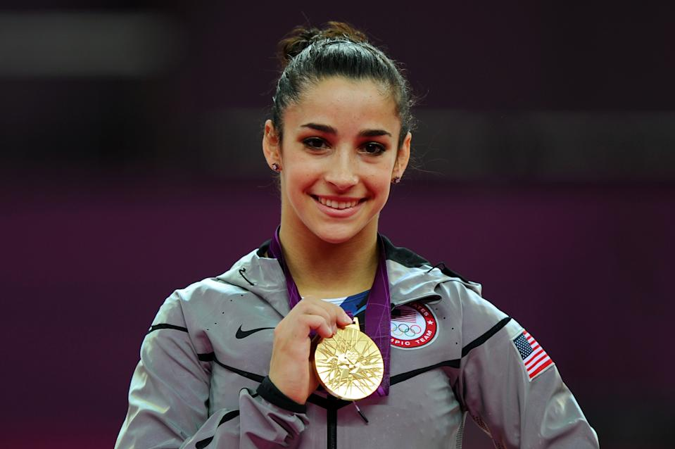 """Gold medalist <a href=""""http://sports.yahoo.com/olympics/gymnastics/alexandra-raisman-1134192/"""" data-ylk=""""slk:Alexandra Raisman"""" class=""""link rapid-noclick-resp"""">Alexandra Raisman</a> of the United States poses on the podium during the medal ceremony for the Artistic Gymnastics Women's Floor Exercise final on Day 11 of the London 2012 Olympic Games at North Greenwich Arena on August 7, 2012 in London, England. (Photo by Michael Regan/Getty Images)"""