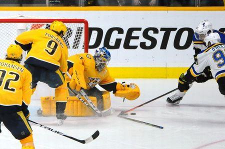 Feb 10, 2019; Nashville, TN, USA; Nashville Predators goaltender Juuse Saros (74) makes a save on a shot by St. Louis Blues right wing Vladimir Tarasenko (91) and center Ryan O'Reilly (90) during the third period at Bridgestone Arena. Mandatory Credit: Christopher Hanewinckel-USA TODAY Sports
