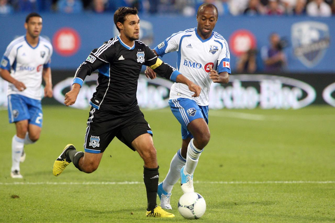 MONTREAL, CANADA - AUGUST 18:  Chris Wondolowski #8 of the San Jose Earthquakes moves the ball past Collen Warner #18 of the Montreal Impact during the match at the Saputo Stadium on August 18, 2012 in Montreal, Quebec, Canada.  (Photo by Richard Wolowicz/Getty Images)