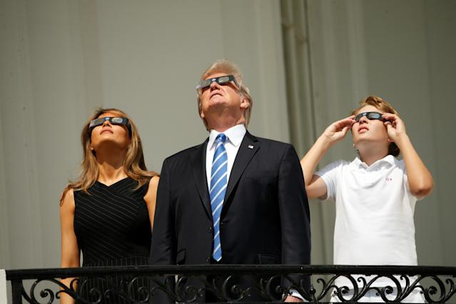 <p>President Donald Trump watches the solar eclipse with first Lady Melania Trump and son Barron from the Truman Balcony at the White House in Washington, Aug. 21, 2017 (Photo: Kevin Lamarque/Reuters) </p>