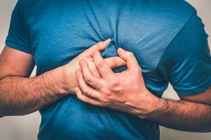 Man having chest pain, heart attack - body pain concept