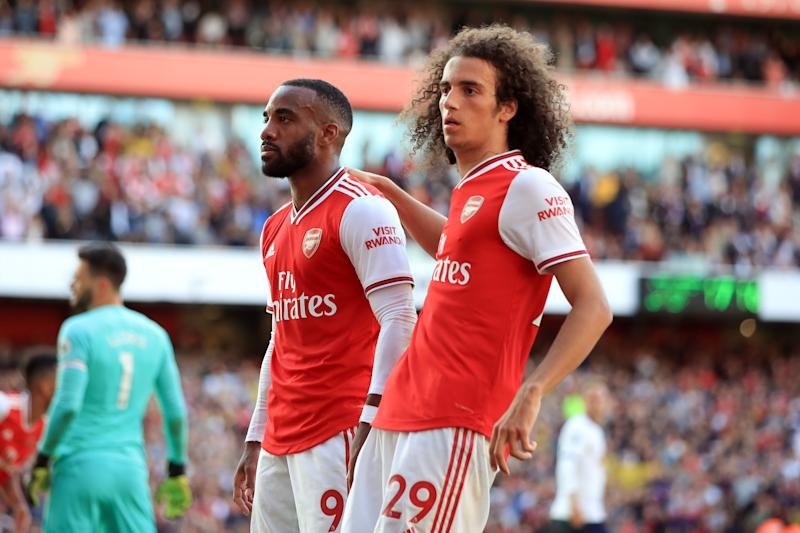 Lacazette and Guendouzi celebrate Arsenal's opener. (Photo by Marc Atkins/Getty Images)