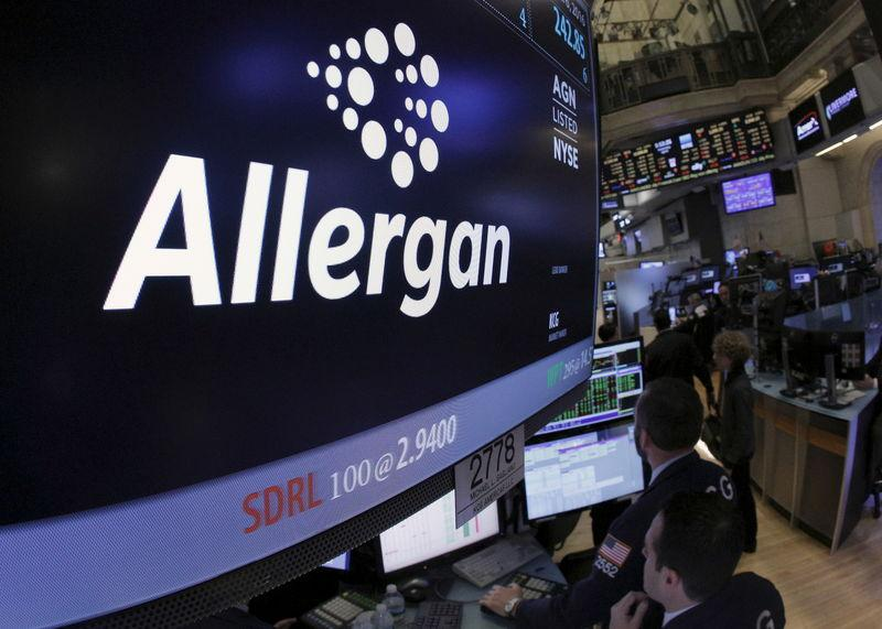 Allergan ticker info and symbol are displayed on a screen on the floor of the NYSE