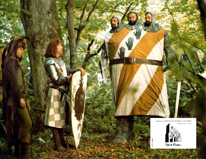 Monty Python And The Holy Grail, lobbycard, from left: Neil Innes, Eric Idle, three heads from left: Terry Jones, Graham Chapman, Michael Palin, 1975. (Photo by LMPC via Getty Images)
