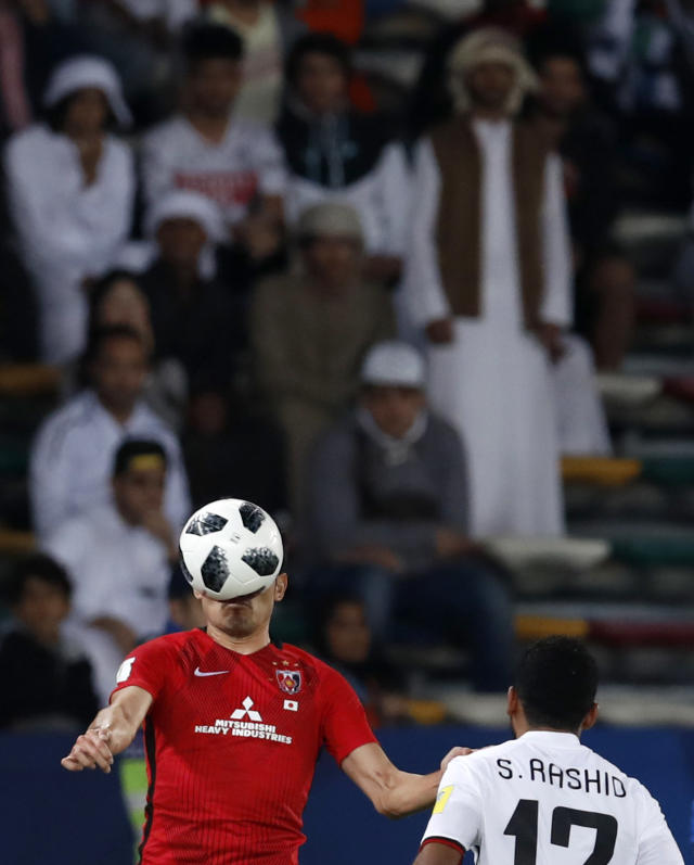 Japan's Urawa Reds Ryota Moriwaki, left, challenges for the ball with Al Jazira's Salim Rashid during the Club World Cup soccer match between Al Jazira Club and Urawa Reds at Zayed sport city in Abu Dhabi, United Arab Emirates, Saturday, Dec. 9, 2017. (AP Photo/Hassan Ammar)