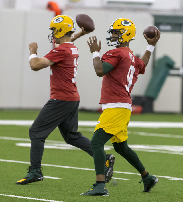 Green Bay Packers quarterback Aaron Rodgers, left, and DeShone Kizer throw during NFL football practice Tuesday June 12, 2019 in Green Bay, Wis.. (AP Photo/Mike Roemer)