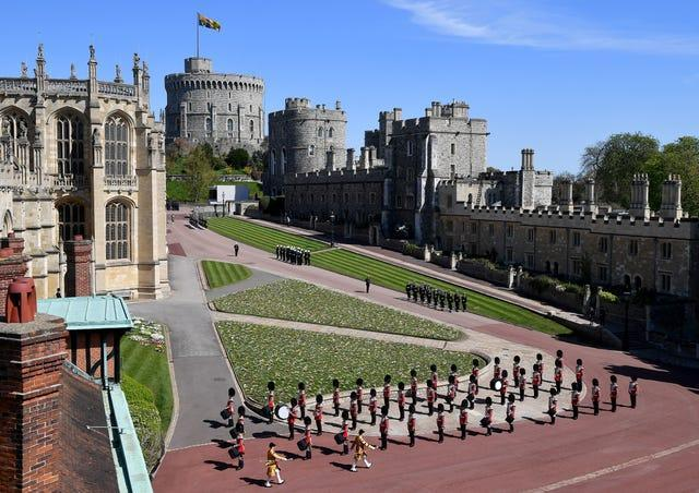 The Foot Guards Band are seen marching outside St George's Chapel, Windsor Castle, Berkshire