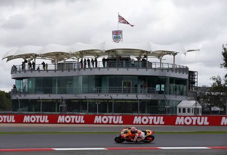 Honda MotoGP rider Marc Marquez of Spain takes a corner during the qualifying session for the British Grand Prix at the Silverstone Race Circuit, central England, August 30, 2014. REUTERS/Darren Staples