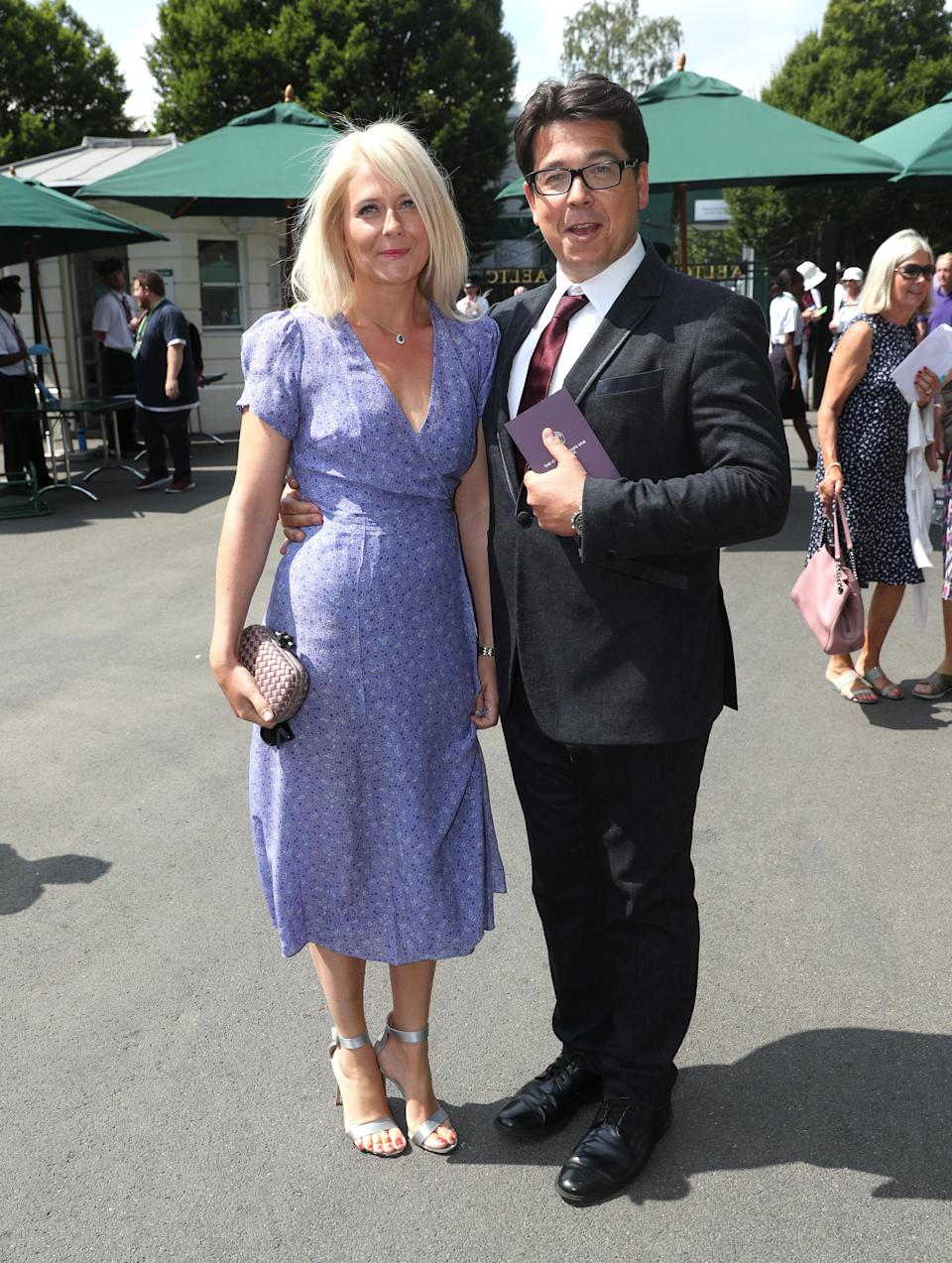 <p>Michael and Kitty McIntyre joined the star-studded crowds at Wimbledon 2018 on 13 July. <em>[Photo: PA]</em> </p>