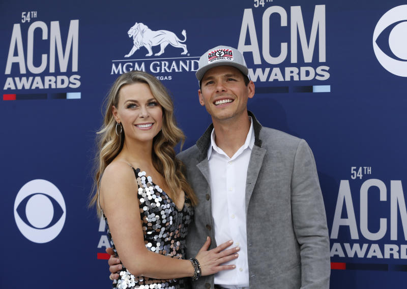 54th Academy of Country Music Awards- Arrivals - Las Vegas, Nevada, U.S., April 7, 2019 - Amber Bartlett and Granger Smith. REUTERS/Steve Marcus