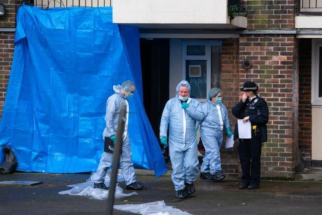 Police forensics officers at the scene on Wisbeach Road in Croydon
