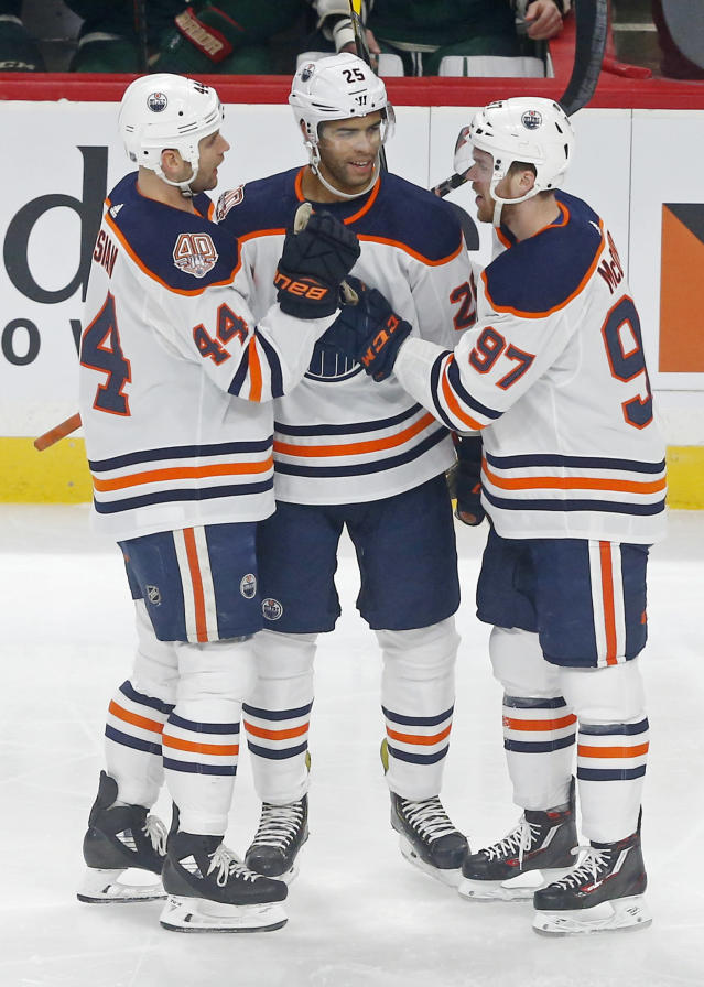 Edmonton Oilers' Darnell Nurse, center, is congratulated by Zack Kassian, left, and Connor McDavid after Nurse scored against Minnesota Wild goalie Devan Dubnyk during the first period of an NHL hockey game Thursday, Feb. 7, 2019 in St. Paul, Minn. (AP Photo/Jim Mone)