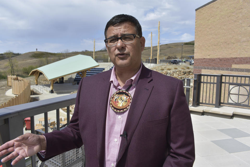 """In this Wednesday, May 19, 2021, photo, Mark Fox, chairman of the MHA Nation, speaks during the opening of the MHA Nation Interpretive Center on the Fort Berthold Indian Reservation in New Town, North Dakota. """"We're one of the few tribes that have elected to develop our energy resources. That's our right,"""" tribal Chairman Mark Fox told AP at the opening of a museum and cultural center built with oil revenue. """"We can develop those resources and do it responsibly so our children and grandchildren for the next 100 years have somewhere to live."""" (AP Photo/Matthew Brown)"""