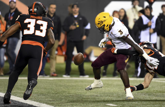 Arizona State running back Eno Benjamin (3) fumbles the ball near the goal line after being hit by Oregon State defensive back David Morris, right, during the second half of an NCAA college football game in Corvallis, Ore., Saturday, Nov. 16, 2019. (AP Photo/Steve Dykes)