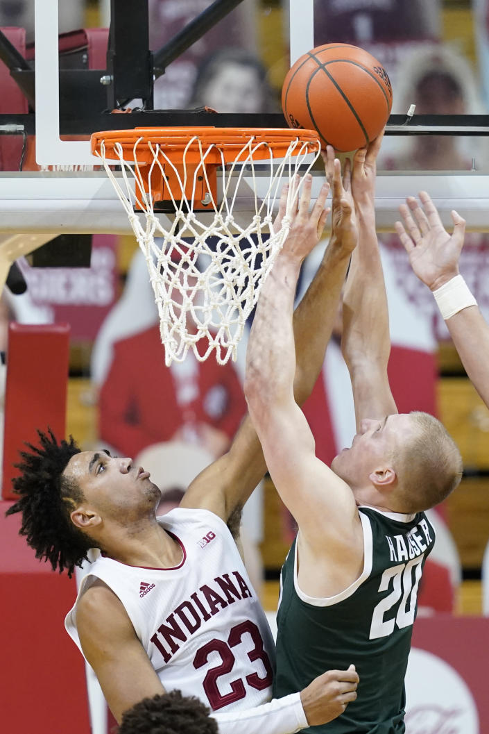 Michigan State's Joey Hauser (20) puts up a shot against Indiana's Trayce Jackson-Davis (23) during the second half of an NCAA college basketball game, Saturday, Feb. 20, 2021, in Bloomington, Ind. Michigan State won 78-71. (AP Photo/Darron Cummings)