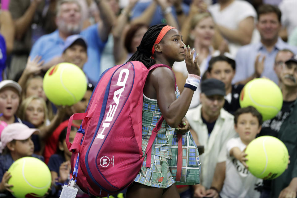 Coco Gauff, of the United States, waves as she walks off court after a loss to Naomi Osaka, of Japan, during the third round of the U.S. Open tennis tournament Saturday, Aug. 31, 2019, in New York. (AP Photo/Adam Hunger)