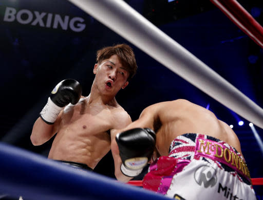 Japanese challenger Naoya Inoue, left, punches British Jamie McDonnell during the first round of their WBA World bantamweight title match in Tokyo Friday, May 25, 2018. Inoue won the match by a technical knockout in the round.(AP Photo/Shuji Kajiyama)
