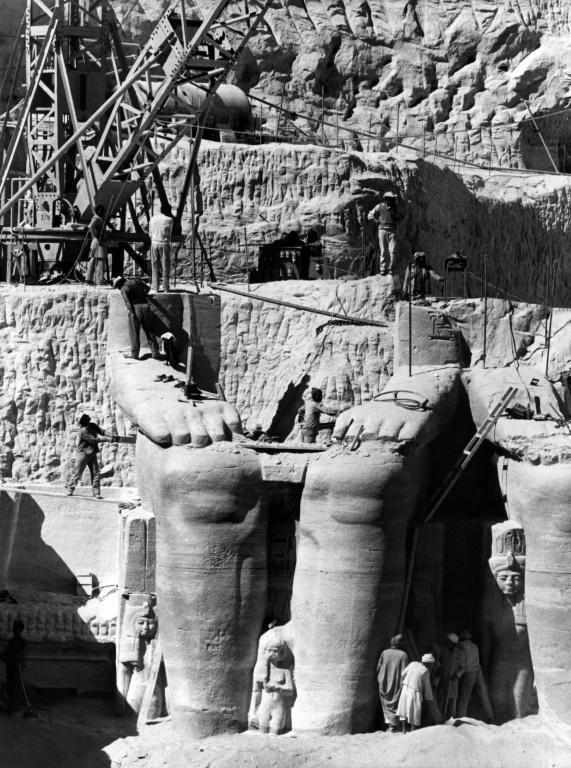 Egyptian workers dismantle a statue of Ramesses II to be moved to the new site of the twin temples of Abu Simbel in January 1966