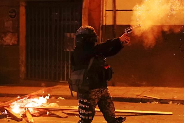 A police officer fires a weapon during clashes between protesters against Bolivia's President Evo Morales and government supporters, in La Paz, Bolivia Nov. 7, 2019. (Photo: Kai Pfaffenbach/Reuters)