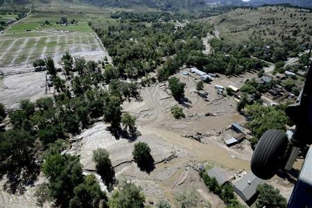 A rescue helicopter flies over Lyons, Colorado which was hard hit by flood waters