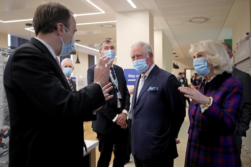 BIRMINGHAM, ENGLAND - FEBRUARY 17: Prince Charles, Prince of Wales and Camilla, Duchess of Cornwall talk with Health Secretary Matt Hancock during a visit to The Queen Elizabeth Hospital on February 17, 2021 in Birmingham, England. (Photo by Molly Darlington - WPA Pool/Getty Images)