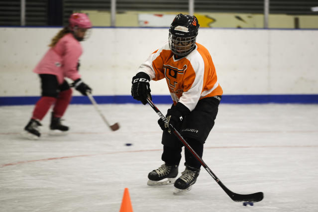 In this Feb. 21, 2019 photo Logan Johnson takes part in a Snider Hockey practice at the Scanlon Ice Rink in Philadelphia. (AP Photo/Matt Rourke)