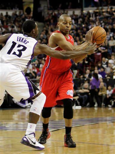 Los Angeles Clippers guard Randy Foye, right, protects the ball from Sacramento Kings guard Tyreke Evans during the first quarter of an NBA basketball game in Sacramento, Calif., Thursday, April 5, 2012. (AP Photo/Rich Pedroncelli)