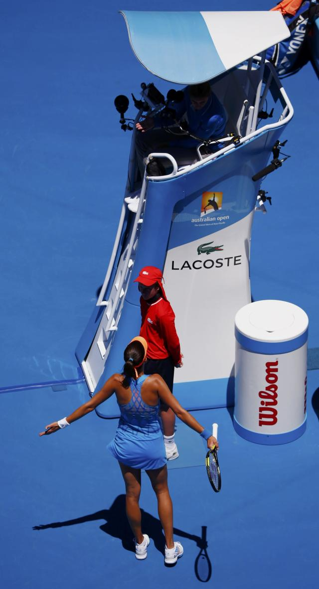 Ana Ivanovic of Serbia argues a call with chair umpire Mariana Alves (top) of Portugal during her women's singles quarter-final match against Eugenie Bouchard of Canada at the Australian Open 2014 tennis tournament in Melbourne January 21, 2014. REUTERS/David Gray (AUSTRALIA - Tags: SPORT TENNIS)