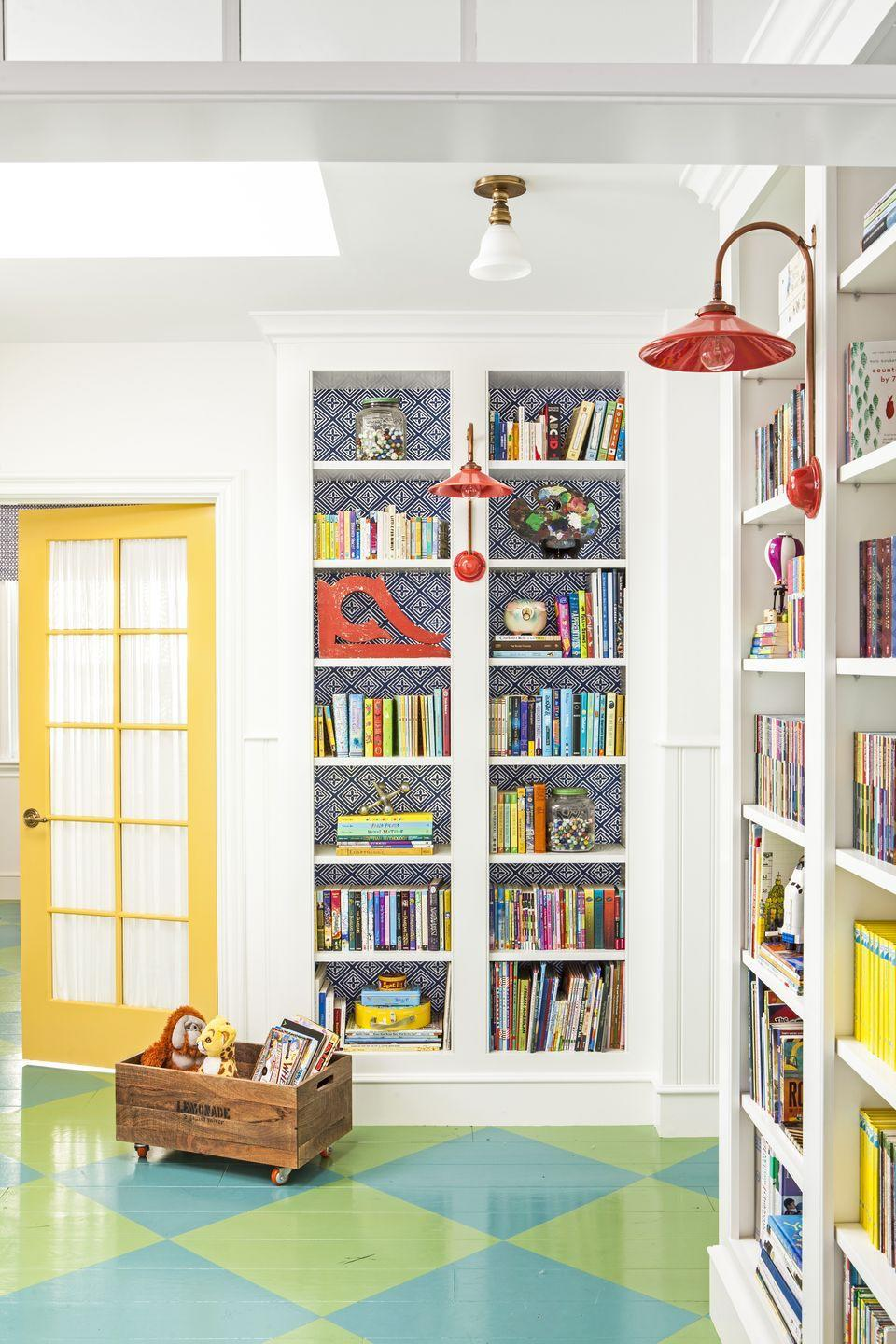 """<p>Just because you're short on square footage doesn't mean you have to deprive yourself of color in a nook-of-a-playroom. There's always room for a bright yellow door—this one in <a href=""""https://www.dunnedwards.com/colors/browser/de5353"""" rel=""""nofollow noopener"""" target=""""_blank"""" data-ylk=""""slk:Golden Crest by Dunn-Edwards Paints"""" class=""""link rapid-noclick-resp"""">Golden Crest by Dunn-Edwards Paints</a>—no matter how small the space. </p>"""