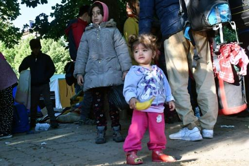 Young children were among the migrants evacuated from a makeshift camp in Sarajevo