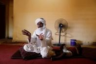 Algateig Mohamed, who fled Inates town with his family to escape jihadist violence, gestures during an interview with Reuters journalists as he sits at his shelter in Niamey