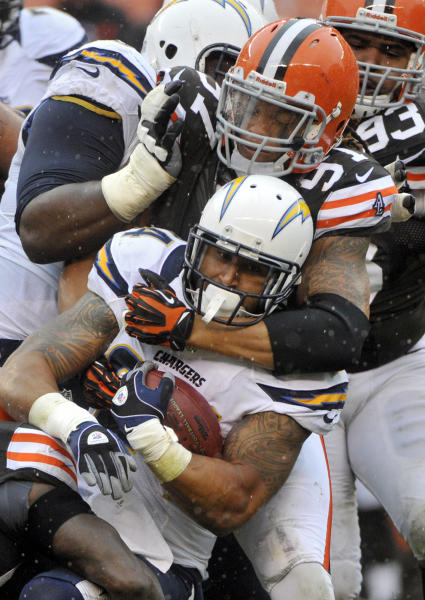 San Diego Chargers running back Ryan Mathews is tackled by Cleveland Browns defensive end Jabaal Sheard (97) in the third quarter of an NFL football game Sunday, Oct. 28, 2012, in Cleveland. (AP Photo/Phil Long)