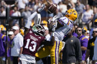 Mississippi State cornerback Emmanuel Forbes (13) knocks away a pass intended for LSU wide receiver Kayshon Boutte (1) during the first half of an NCAA college football game, Saturday, Sept. 25, 2021, in Starkville, Miss. (AP Photo/Rogelio V. Solis)