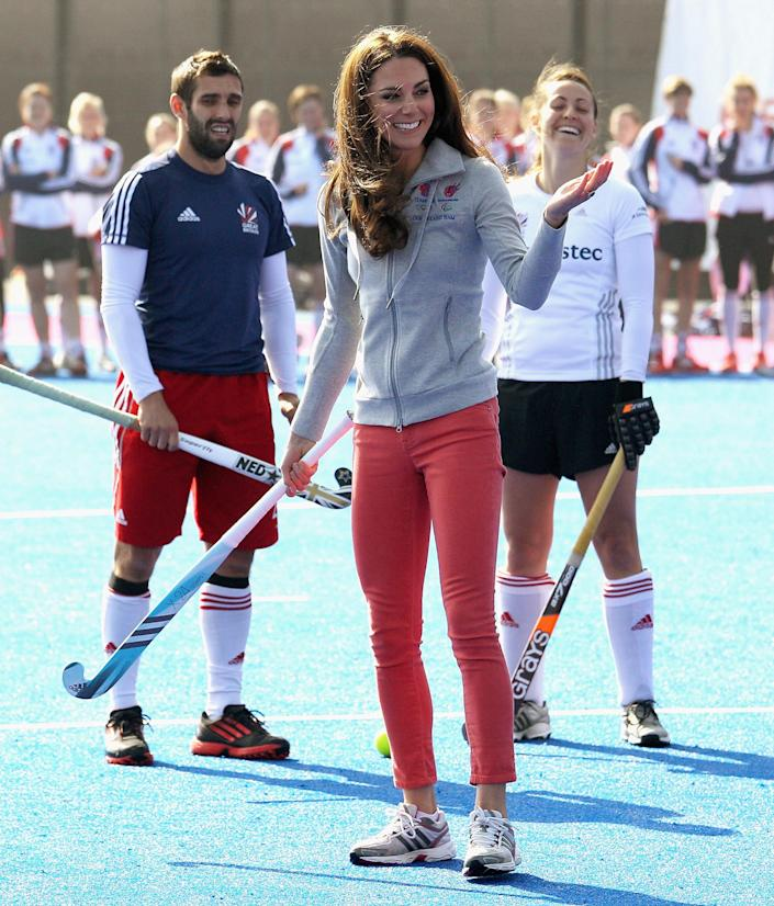Britain's Duchess of Cambridge smiles as she plays hockey with the British Olympic hockey teams at the Riverside Arena in the Olympic Park, London, Thursday March 15, 2012. The Duchess of Cambridge viewed the Olympic Park and met members of the men's and women's British hockey teams. (AP Photo/Chris Jackson, Pool)