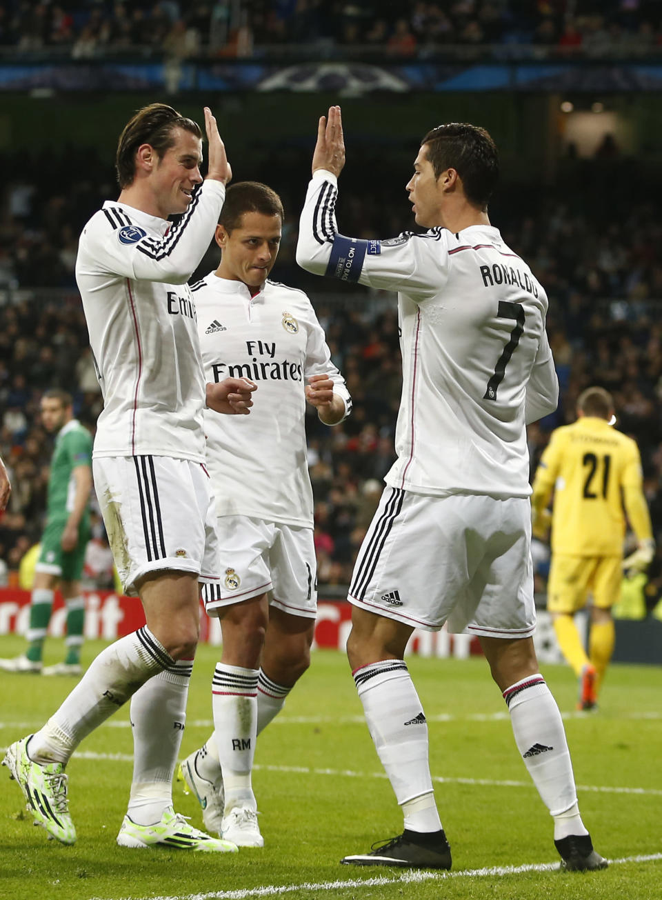 Real Madrid's Gareth Bale, left congratulates Cristiano Ronaldo, right after he scored the team's first goal from a penalty during a Group B Champions League soccer match between Real Madrid and Ludogorets at the Santiago Bernabeu stadium in Madrid, Spain, Tuesday, Dec. 9, 2014. (AP Photo/Andres Kudacki)