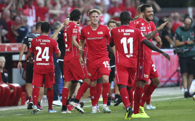 Berlin's Marius Bulter, center, is congratulated after scoring during a German Bundesliga soccer match between FC Union Berlin and Borussia Dortmund in Berlin, Germany, Saturday Aug. 31, 2019. (Andreas Gora/dpa via AP)