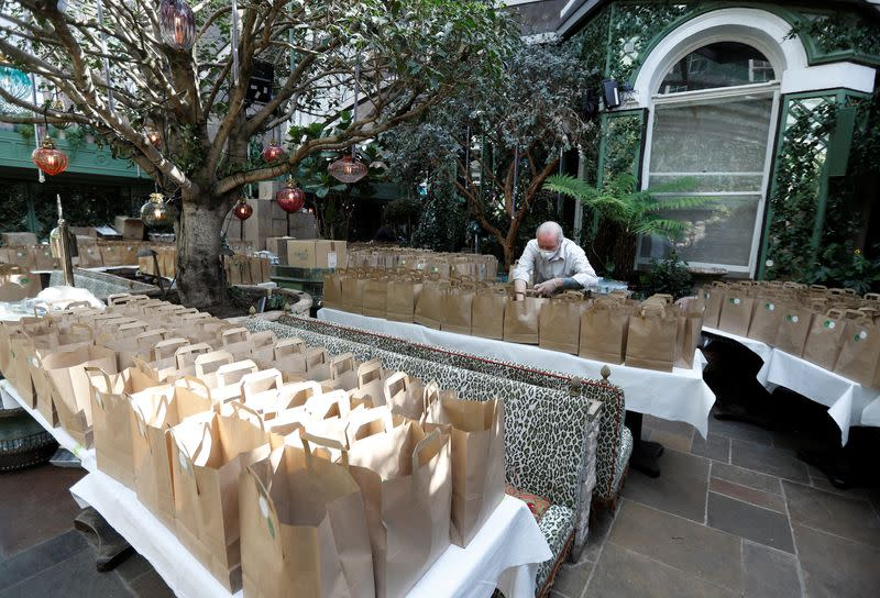 A worker from Annabel's private members club prepares meal packs for NHS staff at their premises in London
